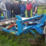 Group of people looking at a sward lifter