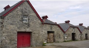 Older style farm buildings constructed of stone with slate roof