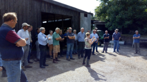 A group of farmers standing in front of a farm shed during the Priority Catchment meeting at Hagbrae