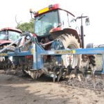 Soil aerator attached to a Case Tractor