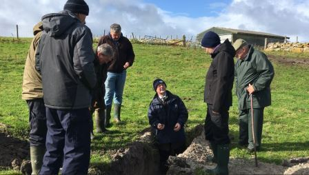 Gavin Elrick in a soil pit during the Uist Soil & Nutrient Network meeitng