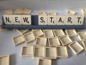 Scrabble letters spelling NEW START